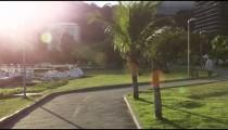 Slow-mo, tracking shot of people biking along the Lagoa in Rio De Janeiro