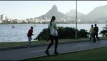 Pedestrians walking along Rio's Lagoa