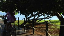 Women biking onto small lake pier