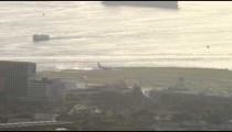 Plane starting to move across Santos Dumont Airport airstrip