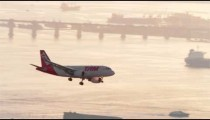An airplane comes into land at Santos Dumont Airport.