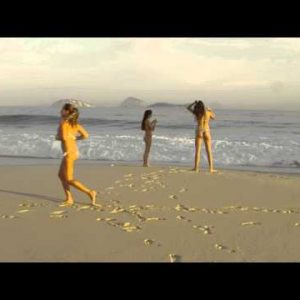 Slow motion, dolly in of two young women on Ipanema beach