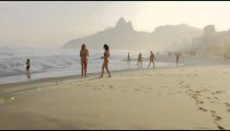 Slow motion, 180 tracking shot of two young women in bikinis on Ipanema beach