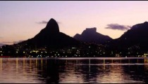 The flickering lights of Rio de Janeiro and Lagoa Rodrigo Freitas.