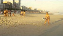 Slow motion footage of a girl playing tennis on Ipanema beach