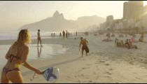 Slow motion track of a girl playing tennis on Ipanema beach
