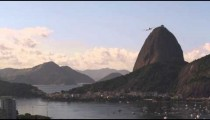 Static footage of an airplane flying over Sugarloaf Mountain - Rio de Janeiro, Brazil.