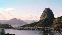 Static, high definition, shot of an airplane flying over Guanabara Bay - Rio de Janeiro, Brazil.