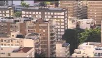 Close pan, from park to residential buildings, of Rio de Janeiro, Brazil.