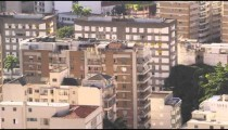 Pan shot of park, street, and apartments in Rio de Janeiro, Brazil.