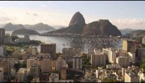 Daylight shot of Rio de Janeiro and traffic on the ocean avenue.