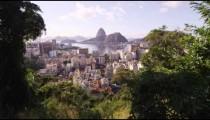 Foliage framed, ultra sharpened, tracking shot of Rio de Janeiro and mountains.