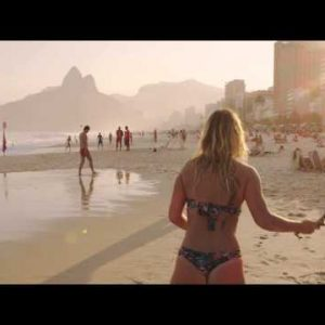 Slow motion, tracking shot of a couple playing tennis on Ipanema beach