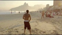 Slow motion shot of a couple playing tennis on Ipanema beach