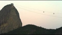 Static shot of a cable cars ascending and descending from Sugarloaf Mountain in Rio.