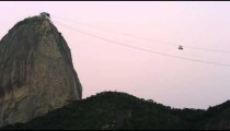Static shot of two cable cars ascending and descending at Sugarloaf Mountain in Rio.
