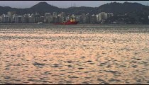 Pan of an evening view of a Rio coastline.