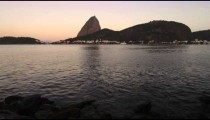 Pan of an evening view of the Rio coastline with Sugarloaf Mountain.