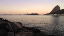Static shot of an evening view of the Rio coastline with Sugarloaf Mountain.