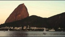 A sailboat on Guanabara Bay in Rio with Sugarloaf Mountain in the distance.