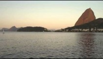 Static shot of Guanabara Bay with Sugarloaf Mountain in the distance.