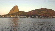 Pan across Guanabara Bay in Rio de Janeiro with mountains in the distance.