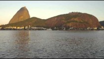 Static shot of Guanabara Bay in Rio de Janeiro with mountains in the distance.
