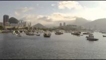 Slow pan of anchored boats in a hazy Rio marina.