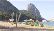 Static shot of people on a Rio beach.