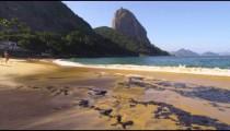Slow motion of a seaweed strewn Rio beach.
