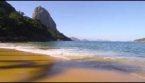 Slow motion of waves washing up at Red Beach in Rio.