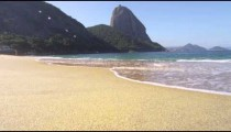 Static shot of waves washing up on Rio's Red Beach.