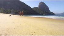 Slow motion of women walking on a Rio beach.