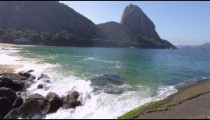 Slow motion shot of waves washing up on Red Beach in Rio.