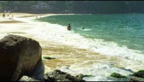 Slow motion of waves rolling onto Red Beach in Rio.
