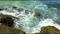 Slow motion of waves crashing on rocks in Rio.