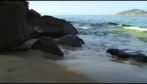 Slow motion of waves crashing on rocks at Red Beach in Rio.