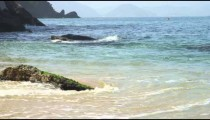 Slow motion of waves swirling ashore at Rio's Red Beach.
