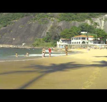 Slow motion of people on Rio's Red Beach.