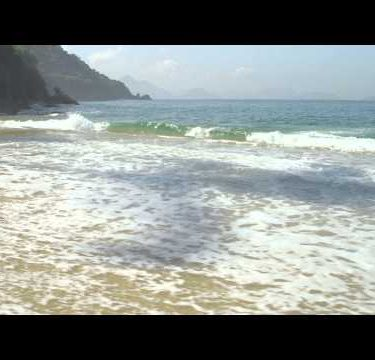 Slow motion of waves ebbing and flowing on the sand at Rio's Red Beach.