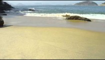 Slow motion of waves flowing onto Red Beach in Rio.