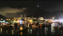 Sped up shot of a nighttime Rio across dark water.