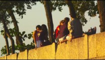 Static shot of people atop a retaining wall in Rio.