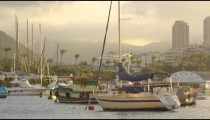 Pan of picturesque fishing boats in a Rio harbor.
