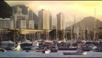 Static shot of Guanabara Bay with various boats and buildings in the distance.