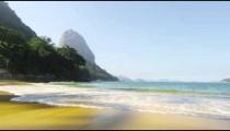 Static shot of waves washing Red Beach in Rio de Janeiro.
