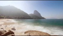 Sped up shot of waves on Red Beach in Rio.