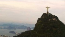 The Cristo Redentor statue from the back in a circling helicopter, in Rio de Janeiro, Brazil.