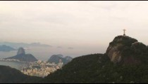 Tracking shot of Rio's Christ the Redeemer monument to the city far below.