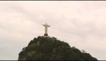 Tracking shot of Christ the Redeemer atop Rio's Corcovado Mountain.